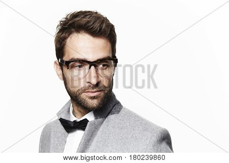 Smartly dressed dude wearing bow tie studio shot