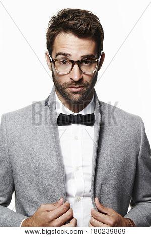 Smart guy in bow tie and grey coat portrait