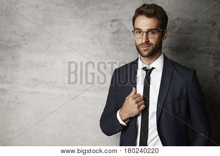 Businessman smiling in spectacles portrait studio shot