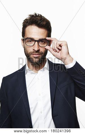 Handsome Businessman focusing spectacles portrait studio shot