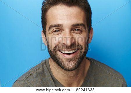 Happy chap in blue studio portrait studio shot