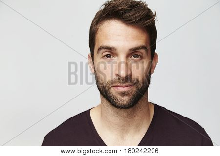 Confident guy looking at camera studio shot
