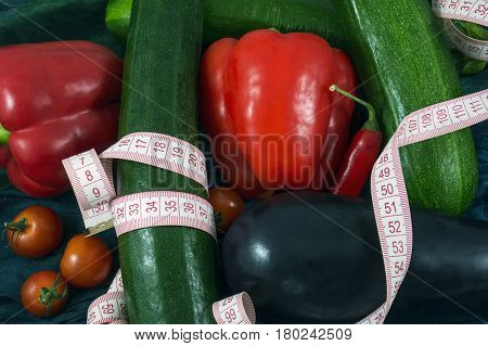 Many fresh vegetables with tape measure on them