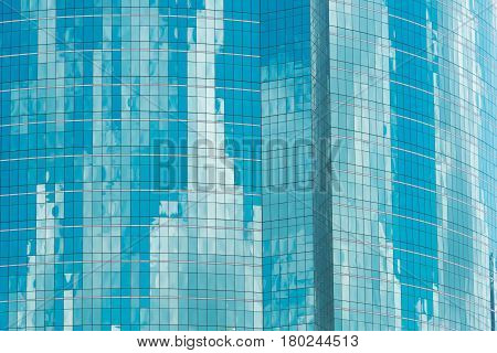 Reflection Of Blue Sky With Clouds In The Windows. Facade Of A Modern Office Building. Modern Indust