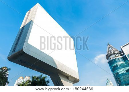 Blank billboard. Blank poster for outdoor advertising. Blank billboard with blue sky and modern building. Big blank billboard for advertisement.