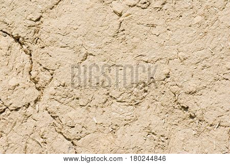 Natural background - wall of an ancient Ukranian clay-walled hut.