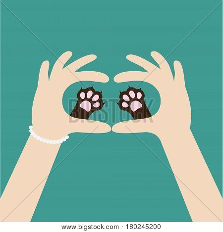 Two womans hands holding cute cat dog paw print. Love and care pet animals. Helping hand concept. Adopt donate. Flat design. Green background. Template. Vector illustration