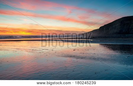 Sunset Over The Beach At Dunraven Bay
