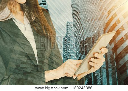Businessman Holding Smart Phone With Wireless Communication Network Icon And Cityscape Background.e-