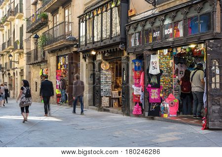 BARCELONA SPAIN - OCTOBER 23 2015: Souvenir's shops in gothic quarter of Barcelona the capital city of the autonomous community of Catalonia in the Kingdom of Spain