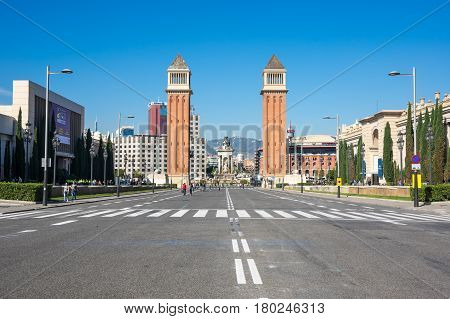 BARCELONA SPAIN - OCTOBER 23 2015: The Venetian Towers (Torres Venecianes) is the popular name for a pair of towers on Avinguda de la Reina Maria Cristina at its junction with Placa d'Espanya in Barcelona Catalonia Spain