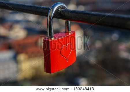 Wedding red lock with heart on a handrail. Symbol of marriage.