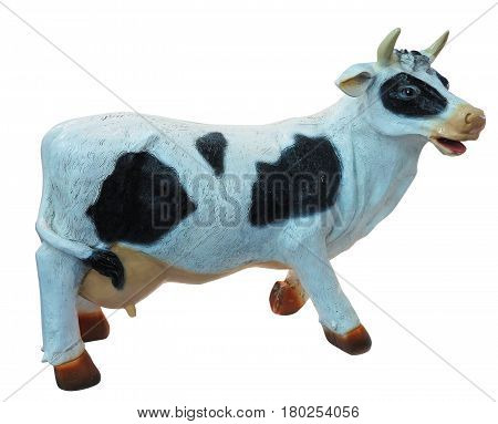 White and black cow toy figurine isolated.