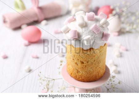 Delicious Easter cake decorated with marshmallow on light table