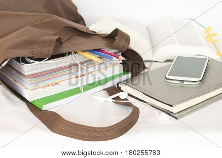 education all book in bag for study prepare go to school on white
