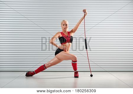 Full length shot of a beautiful young blonde fitness woman in sportswear stretching while working out copyspace health strength sports athlete physique training exercising concept