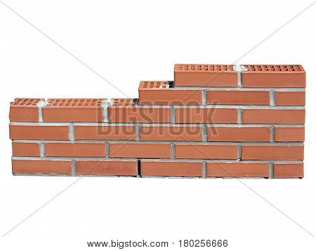 New red brick wall in construction process isolated over white background