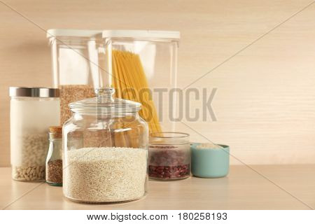 Kitchen containers with groceries on wooden table
