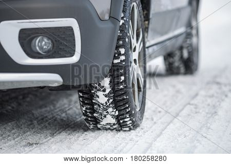 Car with winter tires on a slippery, snowy road