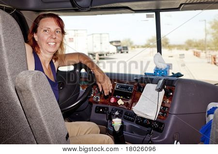 Woman Truck Driver At The Wheel