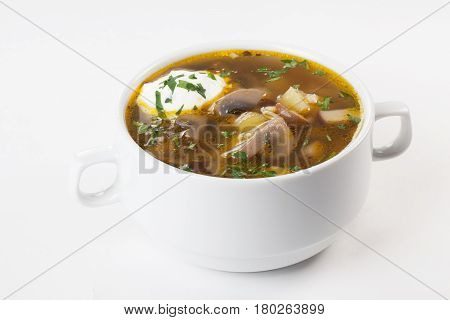 Mushroom broth, mushroom soup, broth, in a bowl with sour cream isolated on white background menu