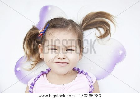 A little girl dressed as a fairy