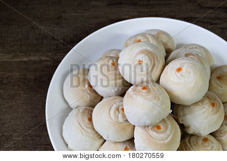 Dessert Chinese pastry or mooncake with salted egg yolk dessert for Chinese new year on wooden.Is one of a series of images of Chinese pastries.