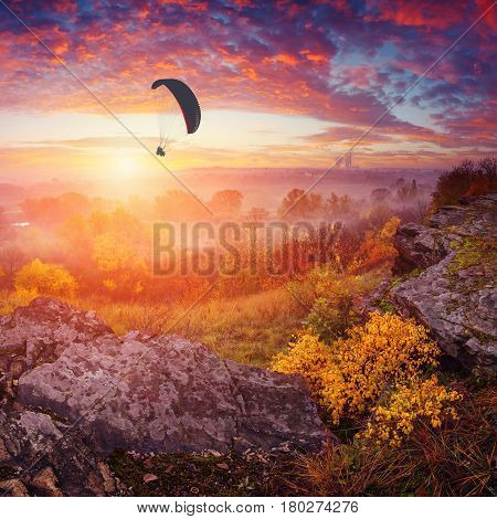 Paraglide In A Sky Above The Misty Valley