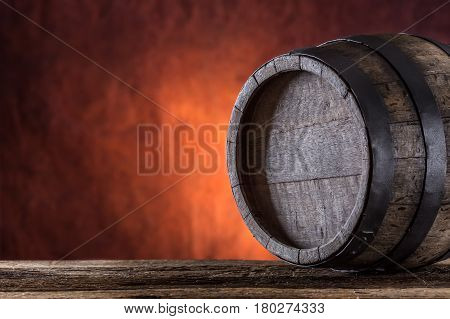 Wooden barrel. Old wooden keg. Barel on beer vine whiskey brandy or cognac.