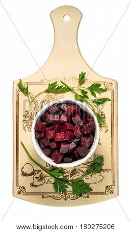 sliced boiled beets on white plate on an old weathered wooden table
