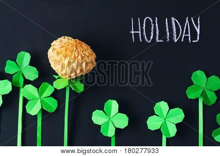 Black blackboard background with origami flowers in summer spring time school holiday