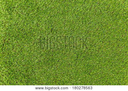 Green background of premium artificial turf .