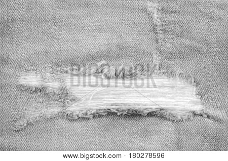 Frayed blue jeans closeup for texture or background.