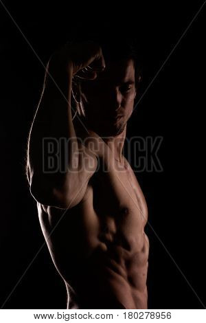 Muscular And Defined Six Pack Abs On Handsome Male Model Posing On Black Background