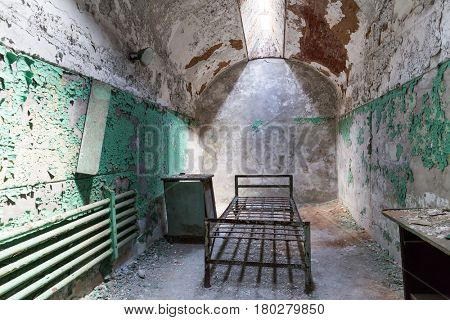 Grunge prison cell with sunlight window