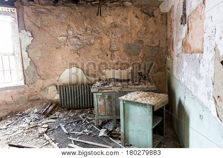 Jail interior with rusty cell.