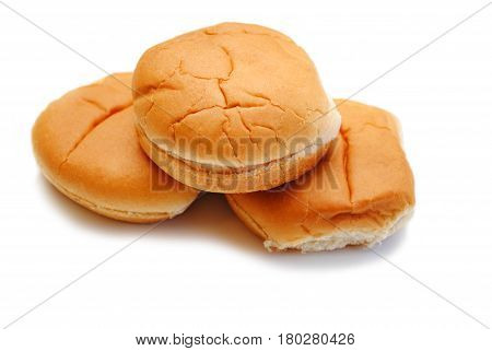 Three Fresh Hamburger Rolls Isolated Over White