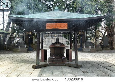 burner stand in Naritasan Temple grounds in Narita Japan 16. april 2012