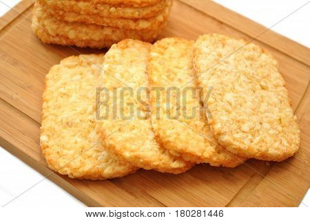 Frozen Potato Hash Browns on a Wooden Cutting Board