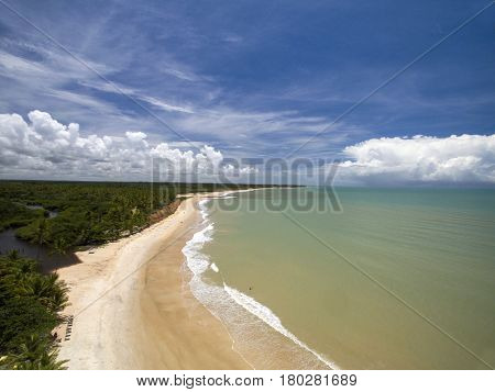 Aerial View Green Sea At A Brazilian Beach Coast On A Sunny Day In Barra Do Cahy, Bahia, Brazil. Feb
