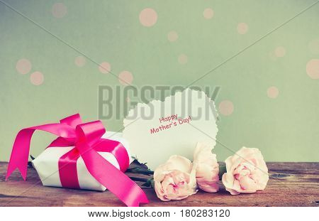 Gift box three pink carnations paper note with words