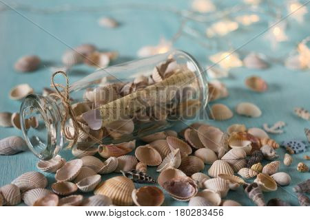 Bottle with a message, seashells. Marine concept.