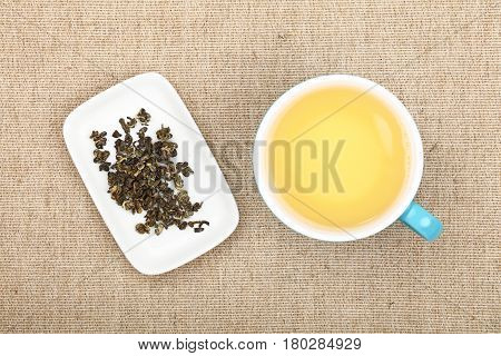 Cup Of Green Tea On Canvas Tablecloth
