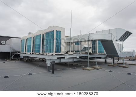 Air and heat conditioning system on top of the building