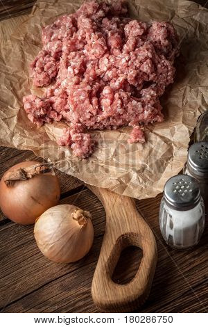 Minced Meat On Wooden Background.