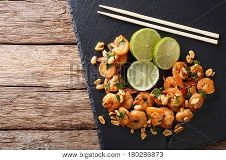 Asian Food: Sauteed Shrimp With Peanuts, Lime And Greens Closeup. Horizontal Top View