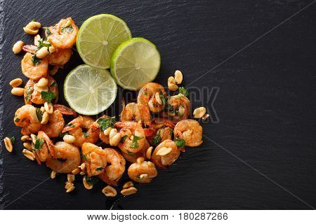 Spicy Sauteed Of Shrimp, Peanuts, Lime And Herbs Closeup. Horizontal Top View