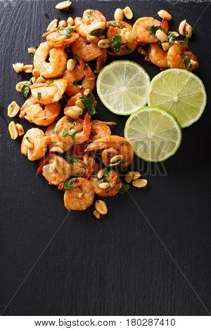 Spicy Sauteed Of Shrimp, Peanuts, Lime And Herbs Closeup. Vertical Top View