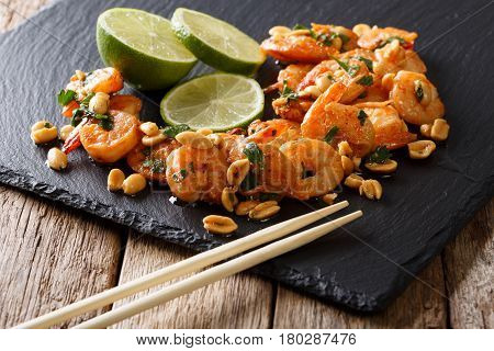 Asian Food: Sauteed Shrimp With Peanuts, Lime And Herb Closeup. Horizontal