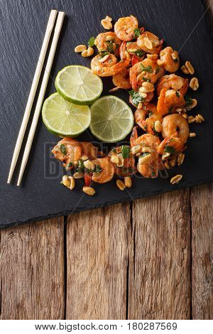 Asian Food: Sauteed Shrimp With Peanuts, Lime And Greens Closeup. Vertical Top View